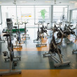 Fitness studio with spin bikes — Stock Photo #48333207