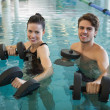Man and woman with dumbbells in the pool — Stock Photo #48333423