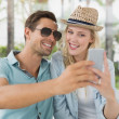 Hip couple taking a selfie together — Stock Photo