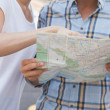 Tourist couple looking at map — Stock Photo #48333959
