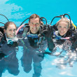 Friends on scuba training in swimming pool — Stock Photo #48334299