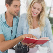 Hipster couple reading book together — Stock Photo #48335063