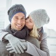 Couple in warm clothing hugging man — Stock Photo