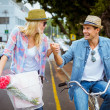 Hip couple going for a bike ride — Stock Photo #48335809