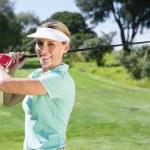Female golfer taking a shot — Stock Photo