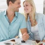 Hip couple having desert and coffee — Stock Photo