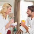 Couple in bathrobes having breakfast — Stock Photo #48336393