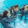 Friends on scuba training in swimming pool — Stock Photo