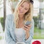 Blonde having coffee sending text — Stock Photo #48337139