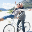Couple going on a bike ride on the beach — Stock Photo #48337207