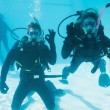 Friends on scuba training submerged in pool — Stock Photo #48338715