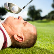 Golfer holding tee in his teeth — Stock Photo #48339737