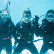 Friends on scuba training submerged in pool — Stock Photo #48339757
