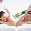 Couple enjoying couples massage poolside — Stock Photo #48339993
