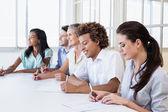 Business team taking notes in meeting — Stock Photo