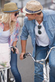 Hip couple going for a bike ride — Foto Stock
