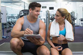 Female bodybuilder with trainer — Stock Photo