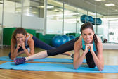 Fit women stretching on exercise mats — Stock Photo