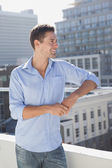 Man looking over on his balcony — Stock Photo