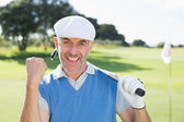 Golfer cheering on putting green — Stok fotoğraf