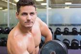 Bodybuilder lifting heavy dumbbell — Stock Photo