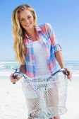 Blonde on bike ride at beach — Foto Stock