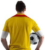 Football player in yellow holding ball — Stock Photo