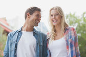 Hip young couple laughing together — Stock Photo