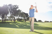 Golfer swinging on the grass — Stock Photo