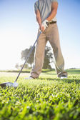 Golfer about to hit golf ball — Stock Photo