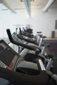 Row of cross trainer machines — Stock Photo