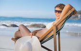 Woman relaxing in deck chair — Stock Photo