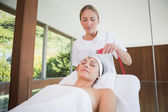 Peaceful brunette getting micro dermabrasion — Stockfoto