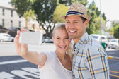 Young hip couple taking a selfie — Foto de Stock
