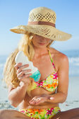 Woman applying suncream — Stock Photo