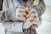 Couple in warm clothing holding hands — Stock Photo