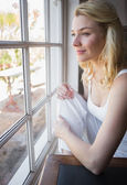 Blonde looking out the window — Stock Photo