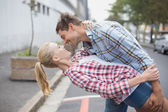 Hip romantic couple dancing in the street — 图库照片