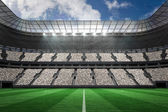 Large football stadium with white fans — Stock Photo