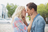 Hip young couple about to kiss — Stock Photo