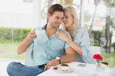 Hip couple enjoying coffee — Stock Photo
