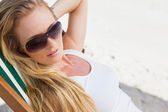 Blonde in sunglasses at beach — Stock Photo