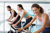 Fit people in a spin class with woman — Stock Photo