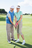 Happy couple putting the ball together — Foto Stock