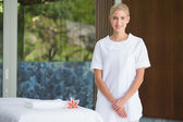 Beauty therapist beside massage towel — Stock Photo