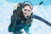 Woman on scuba training in swimming pool — Stok fotoğraf