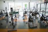 Fitness studio with spin bikes — Stock Photo