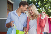 Happy couple on a shopping trip — Foto de Stock