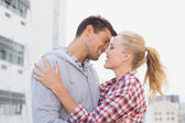 Hip couple hugging about to kiss — Stock Photo