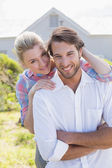 Couple smiling in their garden — Stock Photo